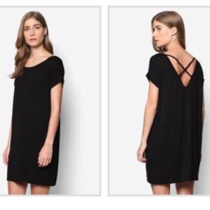 Black t-shirt dress with cross design on the back